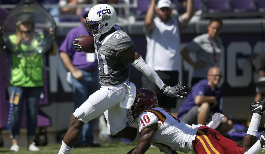 TCU running back Kyle Hicks (21) steps through a tackle from Iowa State defensive back Brian Peavy (10) for a touchdown in the first half of an NCAA college football game, Saturday, Sept. 17, 2016, in Fort Worth, Texas. (AP Photo/Brad Loper)