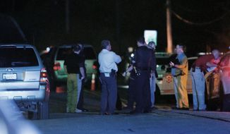Police work the scene of a shooting late Friday, Sept. 16, 2016, in Tulsa, Okla. A Tulsa police officer shot and killed a black man who ignored repeated requests to put up his hands before reaching into an SUV that was stalled in the middle of a street, the police department said. Terrence Crutcher, 40, died at the hospital where he was taken after he was shot by the officer at around 8 p.m. Friday, police said in a news release. (Joey Johnson/Tulsa World via AP)