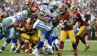 Dallas Cowboys running back Alfred Morris (46) carries the ball into the end zone for a touchdown past Washington Redskins free safety DeAngelo Hall (23) during the second half of an NFL football game in Landover, Md., Sunday, Sept. 18, 2016. (AP Photo/Nick Wass)