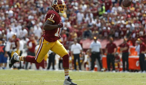 Washington Redskins wide receiver DeSean Jackson (11) chases an overthrown ball during the first half of an NFL football game against the Dallas Cowboys in Landover, Md., Sunday, Sept. 18, 2016. (AP Photo/Alex Brandon)