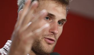 Washington Redskins quarterback Kirk Cousins (8) answers a question during post game interview after an NFL football game against the Dallas Cowboys in Landover, Md., Sunday, Sept. 18, 2016. The Cowboys defeated the Redskins 27-23. (AP Photo/Alex Brandon)