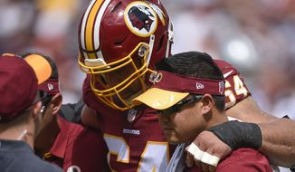 Washington Redskins defensive end Kedric Golston (64) is helped off the field after an injury during the first half of an NFL football game against the Dallas Cowboys in Landover, Md., Sunday, Sept. 18, 2016. (AP Photo/Nick Wass)