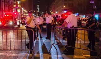 """Police work near the scene of an explosion in Manhattan's Chelsea neighborhood, in New York, Saturday, Sept. 17, 2016. An explosion in a crowded Manhattan neighborhood on Saturday night left more than two dozen people injured, and authorities said a second nearby site was also being investigated. Mayor Bill de Blasio called the blast an """"intentional act,"""" but said there was no terrorist connection.  (AP Photo/Andres Kudacki)"""