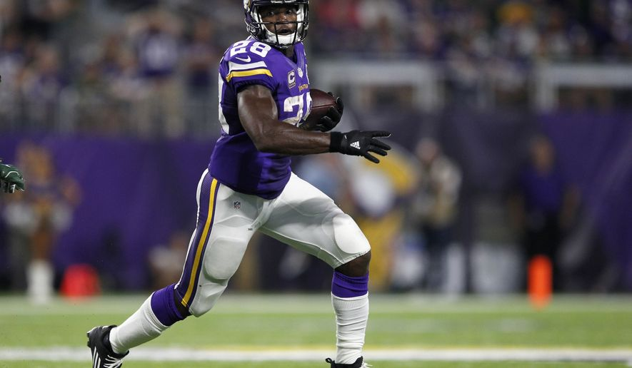 Minnesota Vikings running back Adrian Peterson carries the ball during the first half of an NFL football game against the Green Bay Packers Sunday, Sept. 18, 2016, in Minneapolis. (AP Photo/Andy Clayton-King)