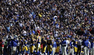 Fans watch during the second half of an NFL football game between the Los Angeles Rams and the Seattle Seahawks at the Los Angeles Memorial Coliseum, Sunday, Sept. 18, 2016, in Los Angeles. (AP Photo/Jae Hong)