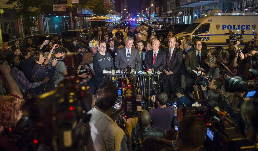 Mayor Bill de Blasio, center, and NYPD Chief of Department James O'Neill, center right, speak during a press conference near the scene of an apparent explosion on West 23rd street in Manhattan's Chelsea neighborhood, in New York, Saturday, Sept. 17, 2016. Police say more than two dozen people were injured in the explosion Saturday night. (AP Photo/Andres Kudacki)