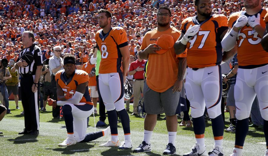 Denver Broncos inside linebacker Brandon Marshall takes a knee during the national anthem before an NFL football game against the Indianapolis Colts, Sunday, Sept. 18, 2016, in Denver. (AP Photo/Jack Dempsey)