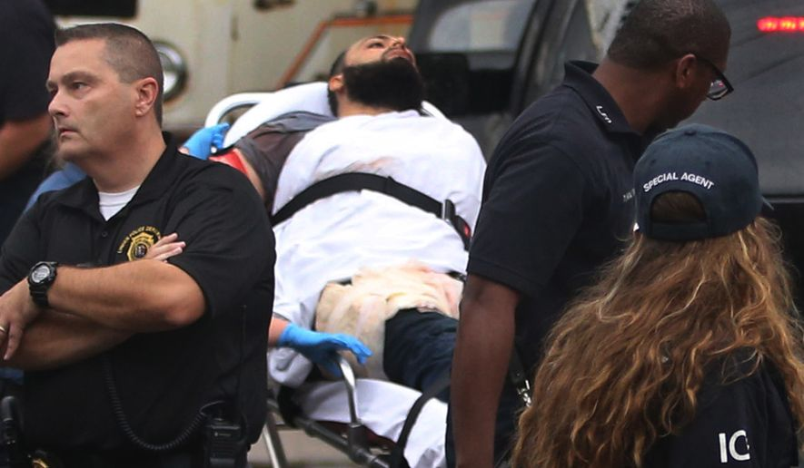 Ahmad Khan Rahami is taken into custody after a shootout with police Monday, Sept. 19, 2016, in Linden, N.J. Rahami was wanted for questioning in the bombings that rocked the Chelsea neighborhood of New York and the New Jersey shore town of Seaside Park. (Ed Murray/NJ Advance Media via AP)