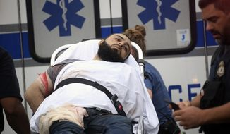 Ahmad Khan Rahami is taken into custody after a shootout with police Monday, Sept. 19, 2016, in Linden, N.J. Rahami was wanted for questioning in the bombings that rocked the Chelsea neighborhood of New York and the New Jersey shore town of Seaside Park. (Nicolaus Czarnecki/Boston Herald via AP) /The Boston Herald via AP)