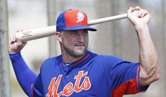 Tim Tebow stretches out before batting practice at the New York Mets' complex, Monday, Sept. 19, 2016, in Port St. Lucie, Fla. The 2007 Heisman Trophy winner and former NFL quarterback got to the complex early Monday, and started his first workout as part of their instructional league team. (AP Photo/Wilfredo Lee) **FILE**