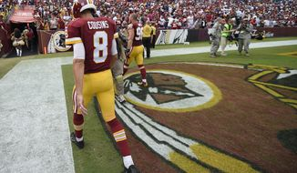 Washington Redskins quarterback Kirk Cousins (8) walks off the field after an NFL football game against the Dallas Cowboys in Landover, Md., Sunday, Sept. 18, 2016. The Cowboys defeated the Redskins 27-23. (AP Photo/Nick Wass)