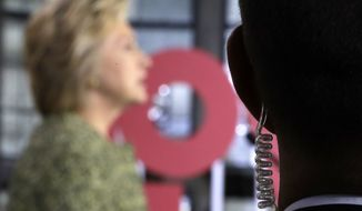 A Secret Service agent stands guard as Democratic presidential candidate Hillary Clinton speaks during a campaign stop at Temple University in Philadelphia, Monday, Sept. 19, 2016. (AP Photo/Matt Rourke)
