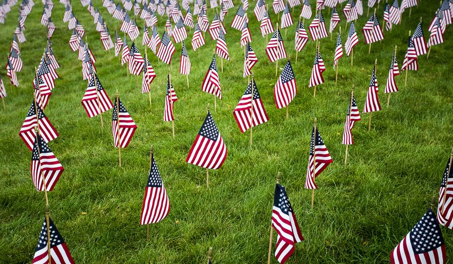 Fifteen years after the Sept. 11 terrorist attacks 2,976 American flags were displayed in memory of each person who died. Families of the victims say they have waited long enough and want legislation granting them the right to sue Saudi officials who they say are culprits. (Associated Press)