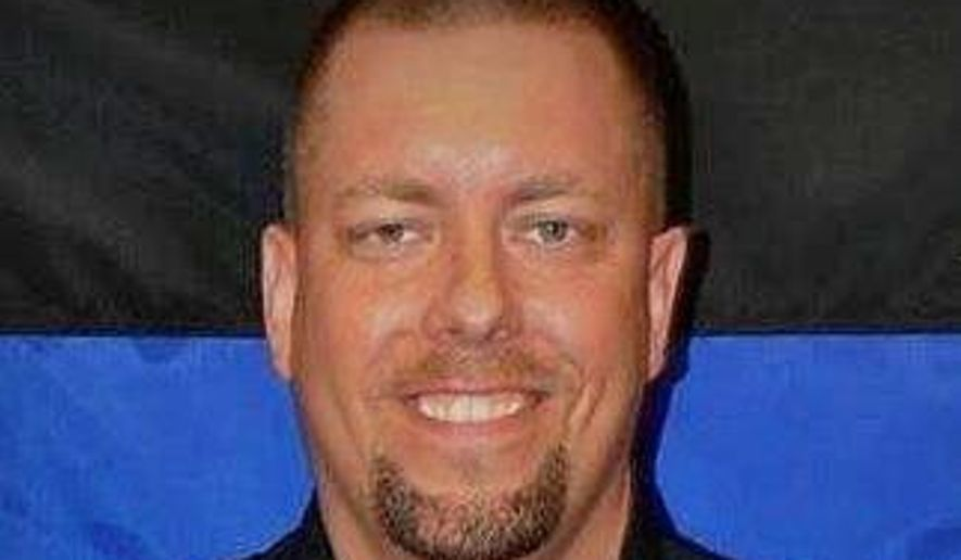 Jason Falconer, who operates a firearms training facility and works part-time with the Avon Police Department. (Avon Police Department/St Cloud Times via AP)