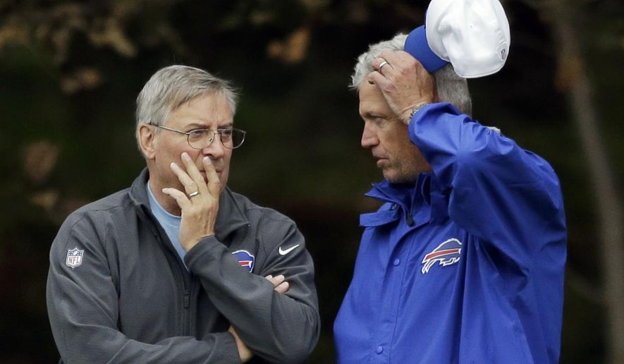 """FILE - In this Oct. 22, 2015, file photo, Buffalo Bills head coach Rex Ryan, right, talks with team owner Terry Pegula during an NFL training session at the Grove Hotel in Chandler's Cross, England. Buffalo Bills owner Terry Pegula tells The Associated Press that Rex Ryan has full authority in overseeing the team and fully supports the coach's decision to fire offensive coordinator Greg Roman.""""Head coach runs the team and staff,"""" Pegula wrote in a text message to the AP in disputing questions about who made the decision to fire Roman on Friday, Sept. 16, 2015. (AP Photo/Matt Dunham, File)"""