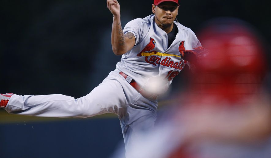 St. Louis Cardinals starting pitcher Carlos Martinez delivers a pitch to Colorado Rockies' Carlos Gonzalez in the first inning of a baseball game Monday, Sept. 19, 2016 in Denver. (AP Photo/David Zalubowski)
