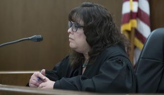 Judge Eileen Paley listens to Marcus Ross, attorney for Demetrius Braxton, as he appears on his client's behalf at Franklin County Municipal Court, Monday, Sept. 19, 2016, in Columbus, Ohio. Columbus police arrested Braxton on a robbery charge Saturday afternoon. Braxton is linked to the 13-year-old Tyre King who was shot fatally by Columbus police after an alleged robbery. Braxton had told The Columbus Dispatch that he was with King on Sept. 14 and that King had a BB gun that looked like a real firearm and wanted to rob someone for money. (AP Photo/John Minchillo)