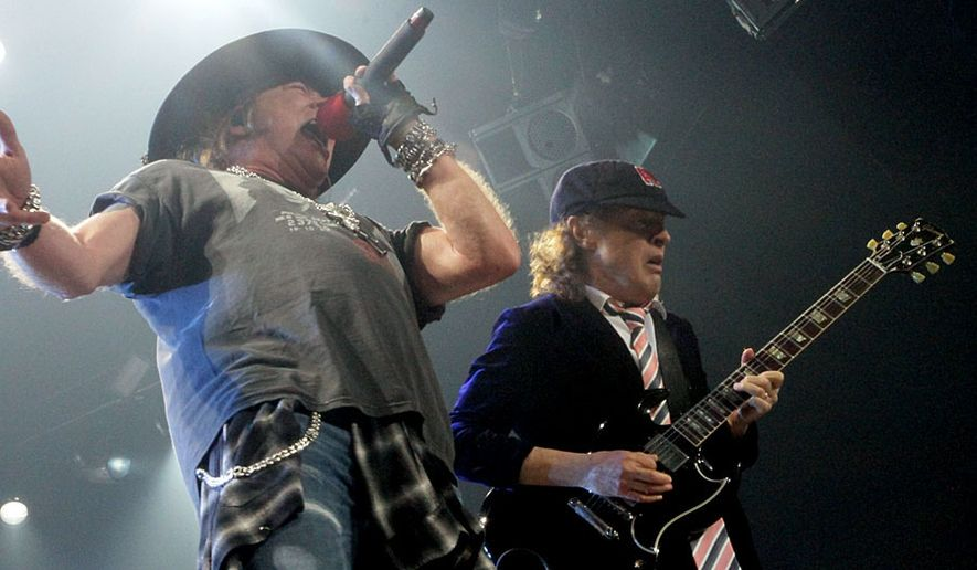 AC/DC, featuring singer Axl Rose and guitarist Angus Young, perform at the Verizon Center in Washington, D.C. on September 17, 2016. (Photograph by Joseph Szadkowski/The Washington Times)