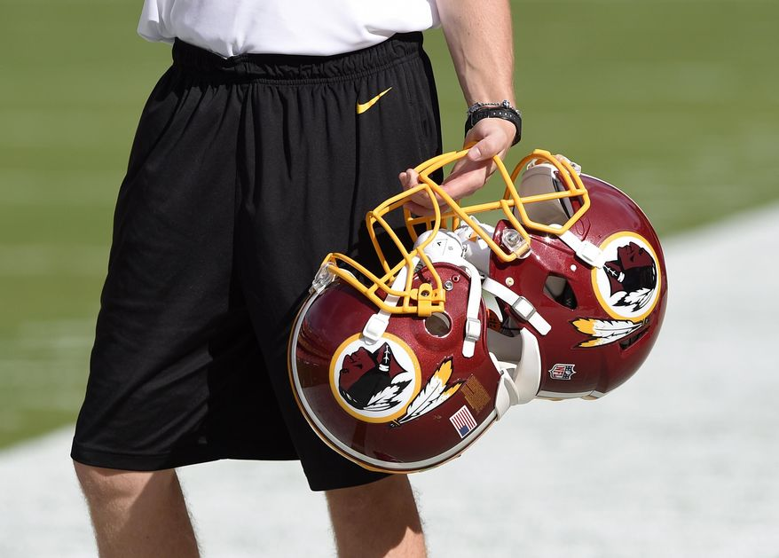 In this Aug. 19, 2016, file photo, Washington Redskins football helmets are seen before an NFL preseason football game between the Washington Redskins and the New York Jets, in Landover, Md. The Supreme Court could decide as early as this month whether to hear the dispute involving the Portland, Oregon-area band. And if the Washington Redskins football team has its way, the justices could hear both cases in its new term. (AP Photo/Nick Wass) ** FILE **
