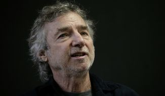 U.S. Filmmaker Curtis Hanson, speaks during an interview at the International Book Fair in Guadalajara, Mexico, Tuesday, Dec. 1, 2009. (AP Photo/Carlos Jasso)