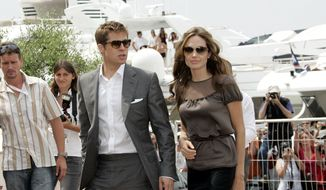 "FILE - In this May 21, 2007 file photo, American actor-producer Brad Pitt, left, and American actress Angelina Jolie arrive for a photo call for the film ""A Mighty Heart,"" at the 60th International film festival in Cannes, southern France. Angelina Jolie Pitt has filed for divorce from Brad Pitt, bringing an end to one of the world's most star-studded, tabloid-generating romances. An attorney for Jolie Pitt, Robert Offer, said Tuesday, Sept. 20, 2016, that she has filed for the dissolution of the marriage. (AP Photo/Virginia Mayo, File) **FILE**"