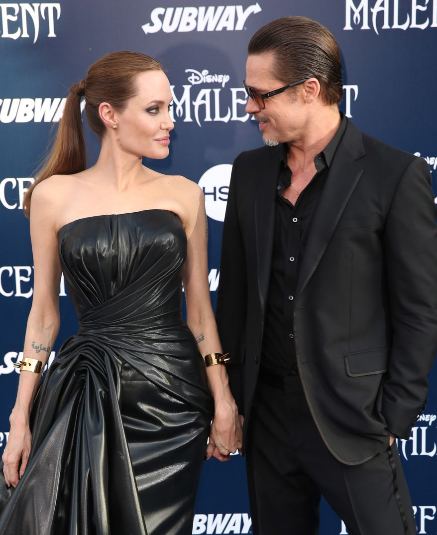"""In this May 28, 2014, file photo, Angelina Jolie and Brad Pitt arrive at the world premiere of """"Maleficent"""" in Los Angeles. Angelina Jolie Pitt has filed for divorce from Brad Pitt, bringing an end to one of the world's most star-studded, tabloid-generating romances. An attorney for Jolie Pitt, Robert Offer, said Tuesday, Sept. 20, 2016, that she has filed for the dissolution of the marriage. (Photo by Matt Sayles/Invision/AP, File) **FILE**"""