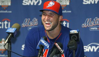 Tim Tebow laughs during a news conference, Tuesday, Sept. 20, 2016, in Port St. Lucie, Fla. The 2007 Heisman Trophy winner and former NFL quarterback practiced at the New York Mets' complex during his second workout as part of their instructional league team. (AP Photo/Wilfredo Lee)