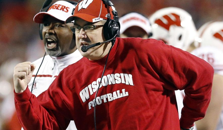 FILE - In this Nov. 7, 2015, file photo, Wisconsin head coach Paul Chryst, foreground, reacts after running back Alec Ingold scored a touchdown in the second half of an NCAA college football game against Maryland. Big Ten teams No. 11 Wisconsin and No. 8 Michigan State play Saturday, Sept. 24, 2016, in East Lansing, Mich.  (AP Photo/Patrick Semansky, File)