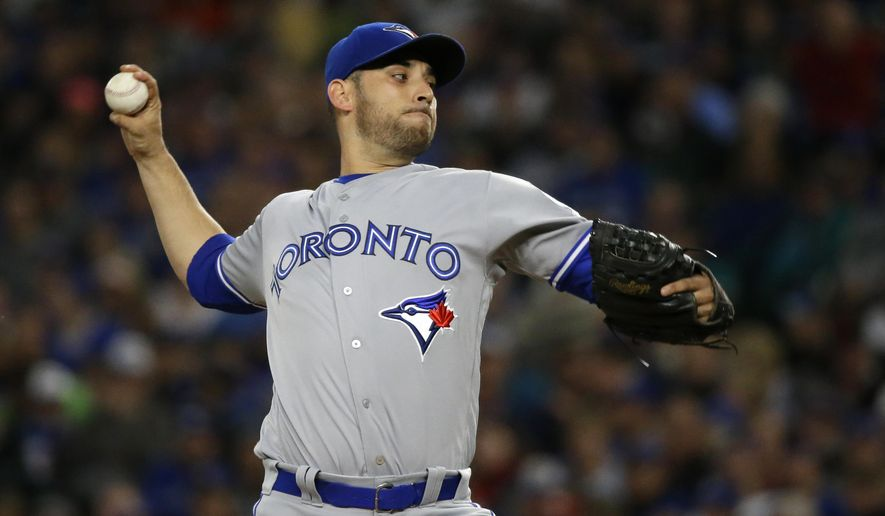 Toronto Blue Jays starting pitcher Marco Estrada throws against the Seattle Mariners in the first inning of a baseball game, Monday, Sept. 19, 2016, in Seattle. (AP Photo/Ted S. Warren)