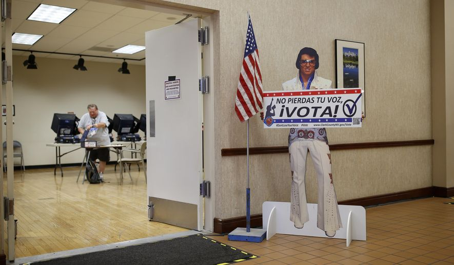 FILE - In this May 31, 2016 file photo, a sign with an Elvis impersonator reminds people to vote at an early primary election polling site, in Las Vegas. Seven weeks before Election Day, hundreds of thousands of voters in key battleground states are already requesting early ballots, a sign of rising interest in the 2016 presidential race.  (AP Photo/John Locher, File)