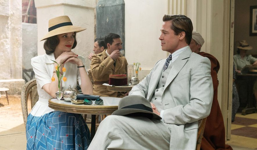 "This image released by Paramount Pictures shows Marion Cotillard, left, and Brad Pitt in a scene from, ""Allied,"" in theaters on November 23. (Daniel Smith/Paramount Pictures via AP)"