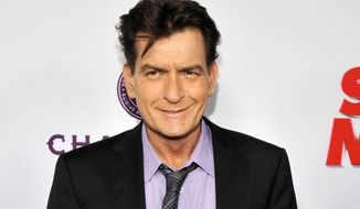 "In this April 11, 2013, file photo, Charlie Sheen, a cast member in ""Scary Movie V,"" poses at the Los Angeles premiere of the film at the Cinerama Dome in Los Angeles. (Photo by Chris Pizzello/Invision/AP, file)"