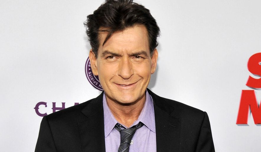 """In this April 11, 2013, file photo, Charlie Sheen, a cast member in """"Scary Movie V,"""" poses at the Los Angeles premiere of the film at the Cinerama Dome in Los Angeles. (Photo by Chris Pizzello/Invision/AP, file)"""
