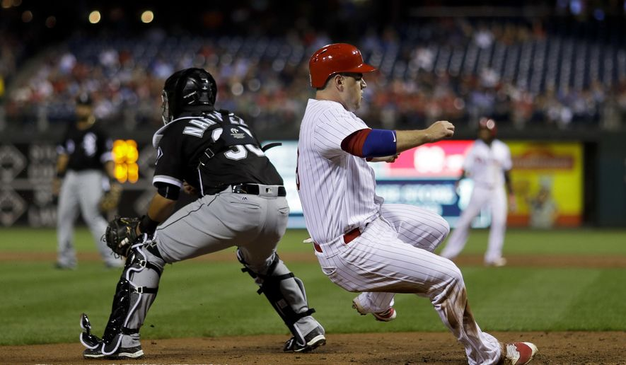 Philadelphia Phillies' Tommy Joseph, right, scores past Chicago White Sox catcher Omar Narvaez on a single by Maikel Franco during the third inning of a baseball game, Tuesday, Sept. 20, 2016, in Philadelphia. (AP Photo/Matt Slocum)
