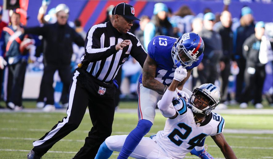 A referee separates New York Giants wide receiver Odell Beckham and former Carolina Panthers and current Washington Redskins cornerback Josh Norman during their game last December.  The much-anticipated rematch between the pair has finally arrived as when the Redskins face the Giants on Sunday. (Associated Press)