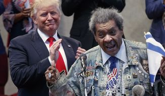 Republican presidential candidate Donald Trump applauds as he is introduced by boxing promoter Don King prior to speaking at the Pastors Leadership Conference at New Spirit Revival Center, Wednesday, Sept. 21, 2016, in Cleveland, Ohio. (AP Photo/ Evan Vucci)