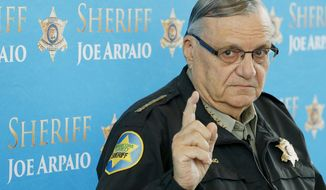 In this Dec. 18, 2013, file photo, Maricopa County Sheriff Joe Arpaio speaks at a news conference at the Sheriff's headquarters in Phoenix. Officials are scheduled to vote Wednesday, Sept. 21, 2016, whether taxpayers will pay $4.4 million in fees to attorneys who won a racial profiling case against Sheriff Arpaio.  (AP Photo/Ross D. Franklin, File)