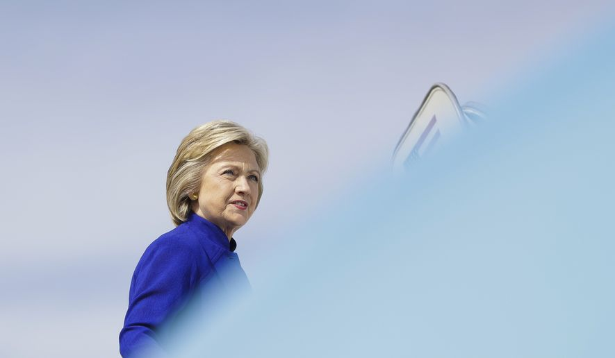 Democratic presidential candidate Hillary Clinton boards her campaign plane at Westchester County Airport, in White Plains, N.Y., Wednesday, Sept. 21, 2016. (AP Photo/Matt Rourke)