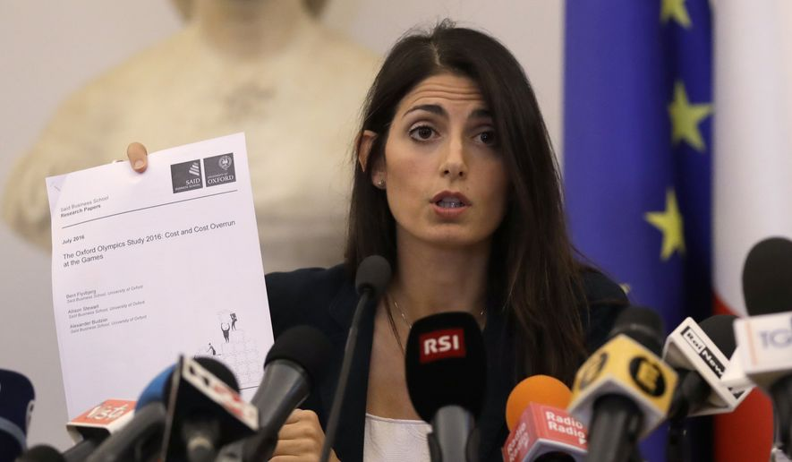 Rome Mayor Virginia Raggi shows the cover of a study by the Oxford University during a press conference, after she did not show up at a scheduled meeting with a delegation of the Italian Olympic Committee, in Rome, Wednesday, Sept. 21, 2016. Raggi says its irresponsible to bid for 2024 Olympic Games, effectively dooming Romes candidacy. (AP Photo/Alessandra  Tarantino)
