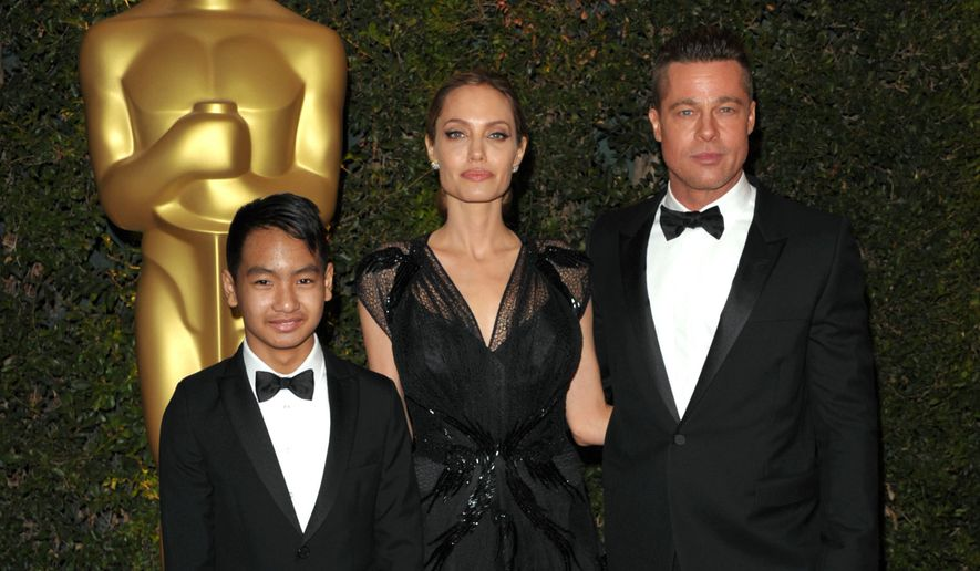 FILE - In this Nov. 16, 2013 file photo, Maddox Jolie-Pitt, from left, Angelina Jolie and Brad Pitt attend the 2013 Governors Awards in Los Angeles.  Jolie Pitt filed for divorce from her husband on Sept. 19, 2016, demanding sole physical custody of their six children.  (Photo by John Shearer/Invision/AP, File)