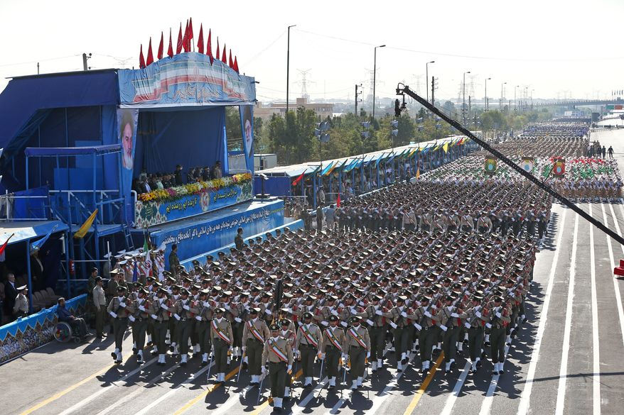 Iranian armed forces members march in a military parade marking the 36th anniversary of Iraq's 1980 invasion of Iran, in front of the shrine of late revolutionary founder Ayatollah Khomeini, just outside Tehran, Iran, Wednesday, Sept. 21, 2016. (AP Photo/Ebrahim Noroozi) ** FILE **