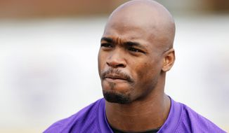 FILE - In this July 29, 2016, file photo, Minnesota Vikings running back Adrian Peterson is shown during the first day of the NFL teams training camp at Mankato State University in Mankato, Minn. Peterson will undergo surgery on his right knee to repair a torn meniscus and Vikings coach Mike Zimmer says the star running back could return this season. Peterson was injured in Sunday night's, Sept. 18 victory over Green Bay. (AP Photo/Andy Clayton-King, File)