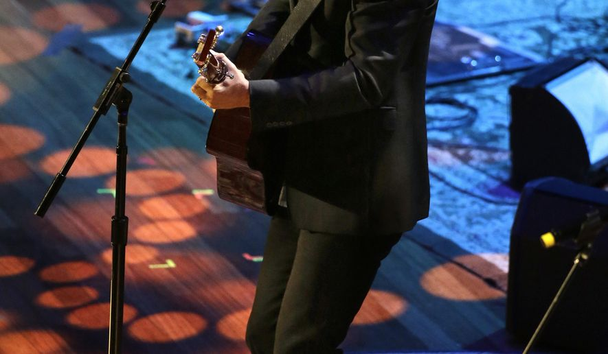 Jason Isbell performs at the Americana Music Association Honors & Awards Show Wednesday, Sept. 21, 2016, in Nashville, Tenn. (AP Photo/Mark Zaleski)