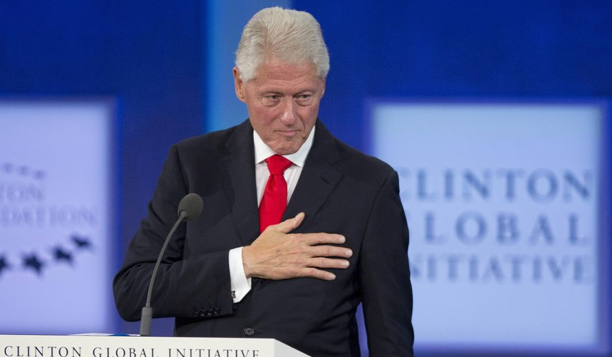 Former U.S. President Bill Clinton holds his hand to his chest to acknowledge applause as he makes departing remarks on the final day of the Clinton Global Initiative, Wednesday, Sept. 21, 2016, in New York. (AP Photo/Mark Lennihan)