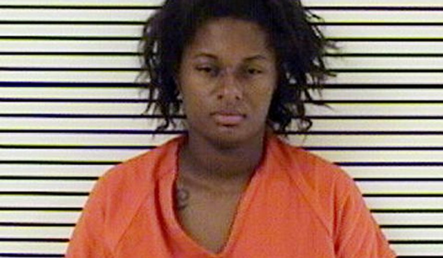 FILE- This undated handout photo provided by the Walker County Sheriff's Department in Walker County Texas shows, Symone Marshall. An autopsy has found the 22-year-old woman who went into convulsions at a Texas jail in May, died after blood clots traveled into her lung. The autopsy released Tuesday, Sept. 20, 2016 by the Harris County Institute of Forensics ruled Marshall died of pulmonary thromboemboli due to deep vein thrombosis. Her manner of death was ruled natural. (Walker Ccounty Sheriff's Department via AP File)