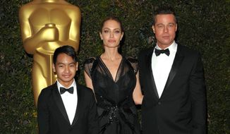 In this Nov. 16, 2013 file photo, Maddox Jolie-Pitt, from left, Angelina Jolie and Brad Pitt attend the 2013 Governors Awards in Los Angeles.  Jolie Pitt filed for divorce from her husband on Sept. 19, 2016, demanding sole physical custody of their six children.  (Photo by John Shearer/Invision/AP, File)