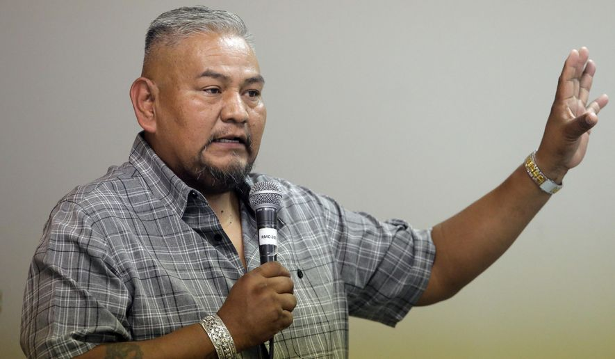 "In this Aug. 22, 2016, photo, Navajo Nation member Davis Filfred speaks during a meeting with the Navajo Tribal Utility Authority at the Red Mesa Chapter, near Montezuma Creek, Utah. Filfred is among the tribal members hoping a federal judge on Wednesday, Sept. 22 grants the group's request for an injunction that would require the county to restore polling places for the November election and staff them with bilingual workers who can help Navajo speakers. ""A lot of Navajos don't understand the mail-in ballot,"" said Filfred. ""They would rather go to a polling place. That's what they're accustomed to and they want that back. (AP Photo/Rick Bowmer)"