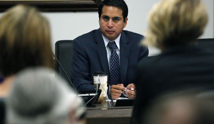 State Rep. Dan Pabon, D-Denver, hears testimony during a hearing of the Colorado state House Marijuana Cost-Benefit Analysis Interim Committee, at the state Capitol, in Denver, Wednesday, Sept. 21, 2016. A panel of state lawmakers voted 5-0 Wednesday, Sept. 21, 2016 to endorse the addition of PTSD to Colorado's 2000 medical pot law. The vote doesn't have legal effect; it's just a recommendation to the full Legislature, which resumes work in January. (AP Photo/Brennan Linsley)