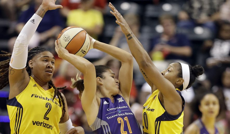 Phoenix Mercury's Marta Xargay (21) is defended by Indiana Fever's Erlana Larkins (2) and Briann January (20) during the first half of a first round WNBA playoff basketball game Wednesday, Sept. 21, 2016, in Indianapolis. (AP Photo/Darron Cummings)