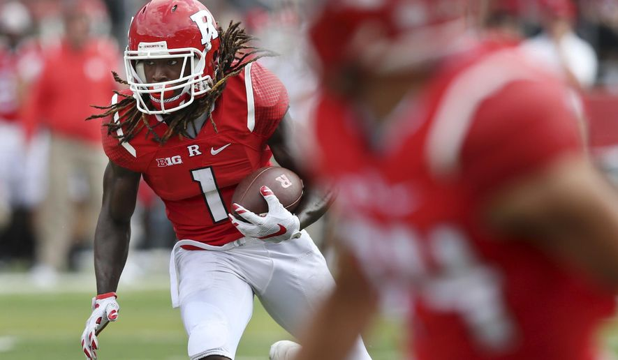 In this Saturday, Sept. 17, 2016, photograph, Rutgers wide receiver Janarion Grant (1) runs for yardage as he turns upfield during the second half of an NCAA college football game against New Mexico in Piscataway, N.J. As Rutgers' return specialist and do-everything offensive player, Grant has had a hand in six touchdowns this season. He has run for three, scored kickoff and punt returns and thrown for a score. The only thing the wide receiver has not done this season is caught a touchdown. (AP Photo/Mel Evans)